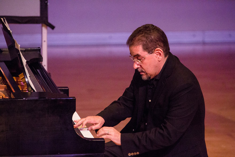 close up of gentleman playing piano
