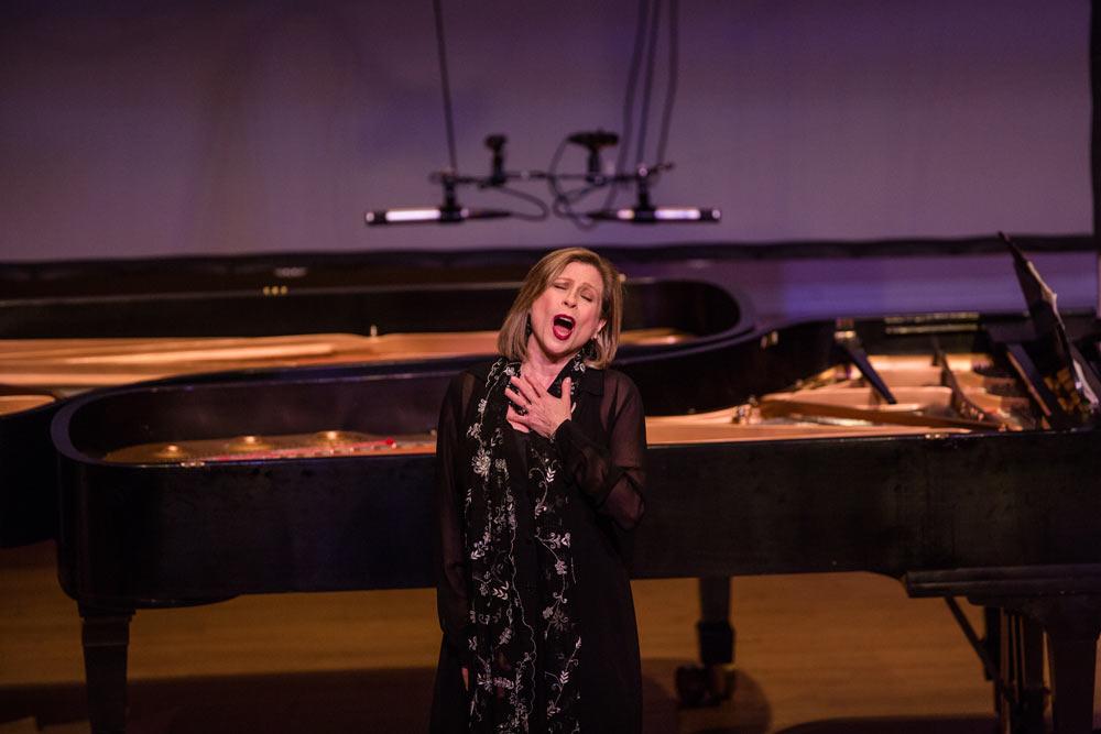 Lori Sims singing on stage