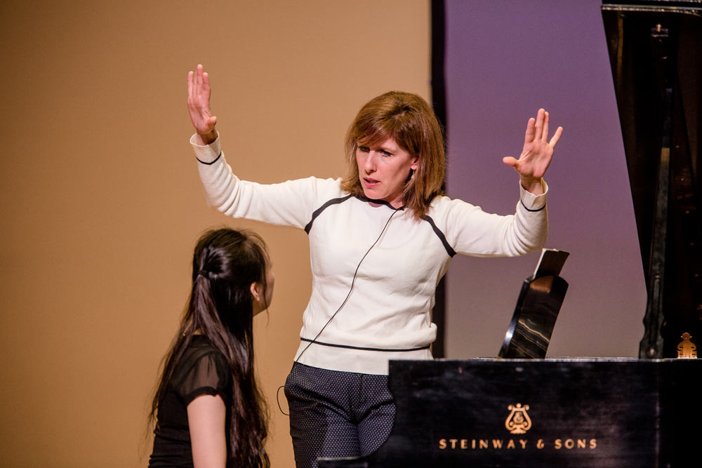 Lori Sims teaching student how to play the piano