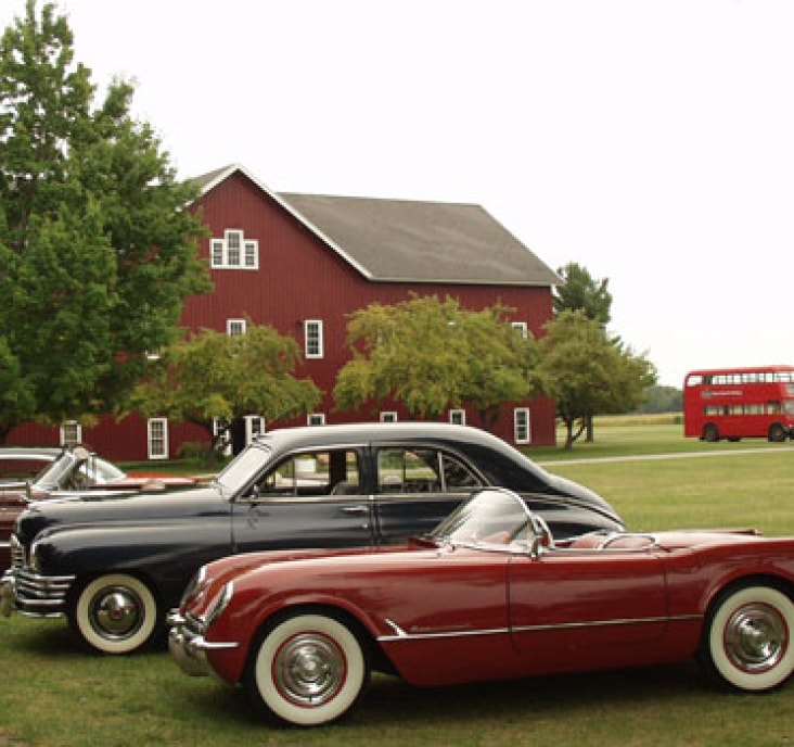 two historical cars parked at Gilmore Car Museum