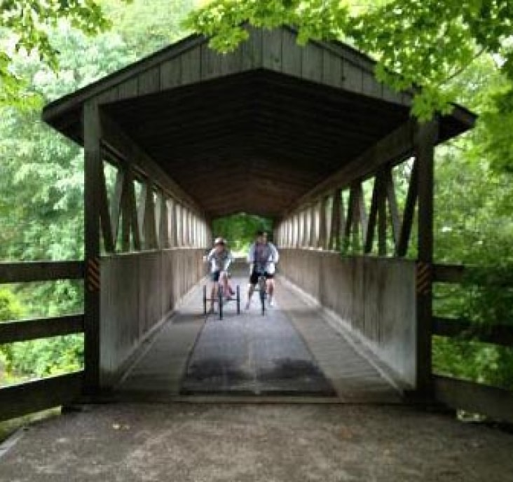 two people riding their bikes on Kal-Haven Trail