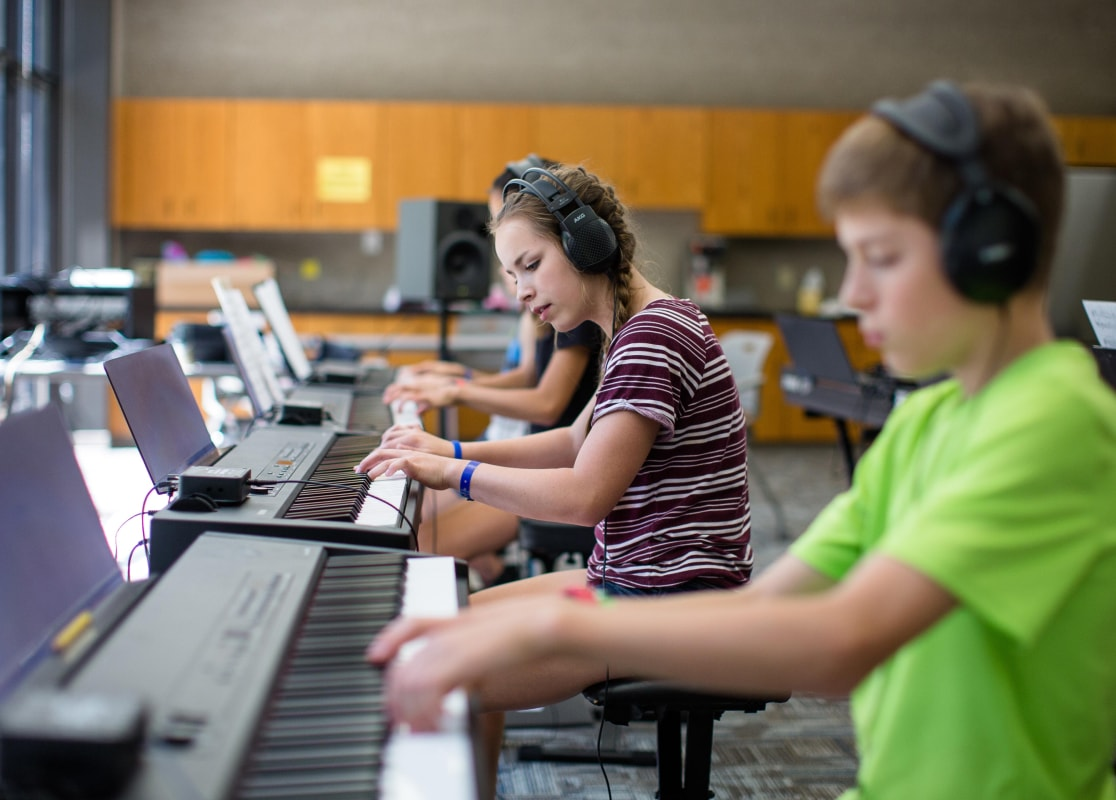 students playing piano at Piano Camp