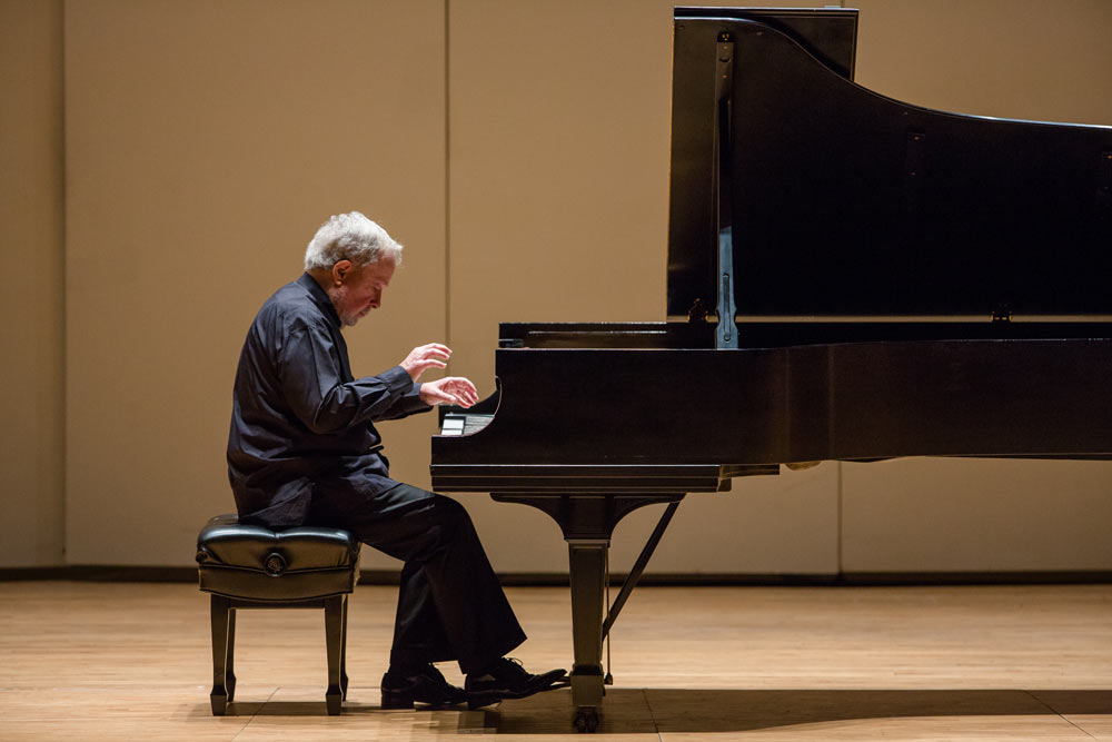 Nelson Freire playing the piano on stage
