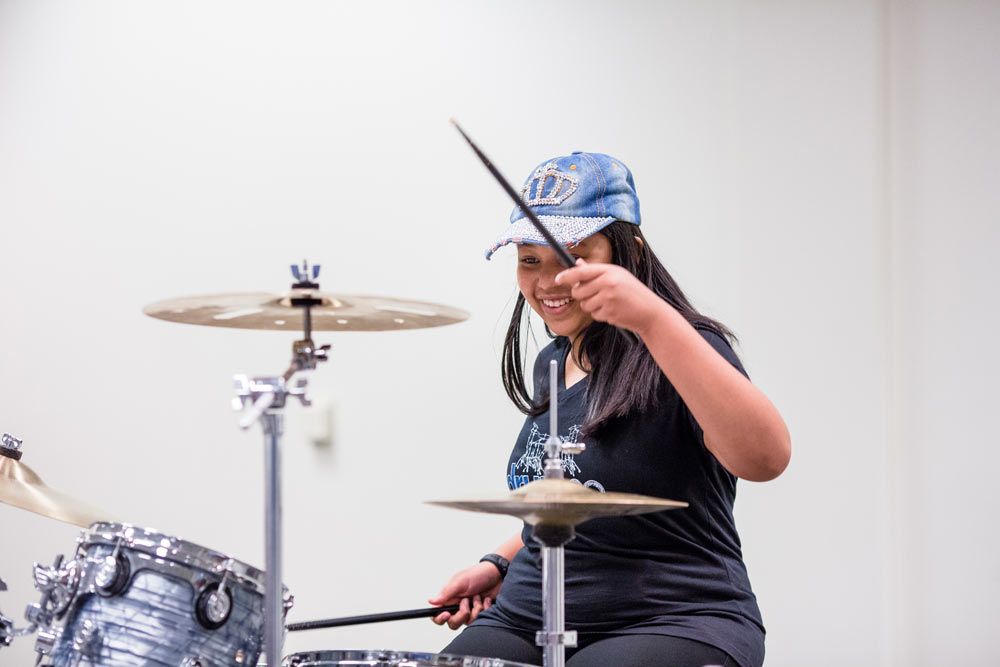close up of a woman playing the drums