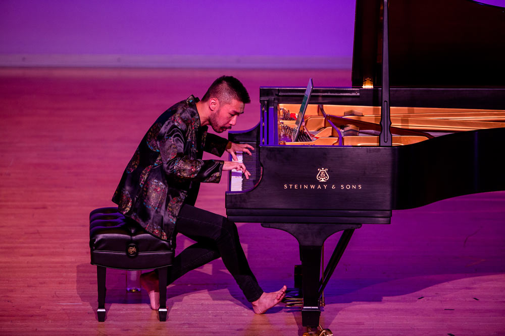 Conrad Tao performing on stage
