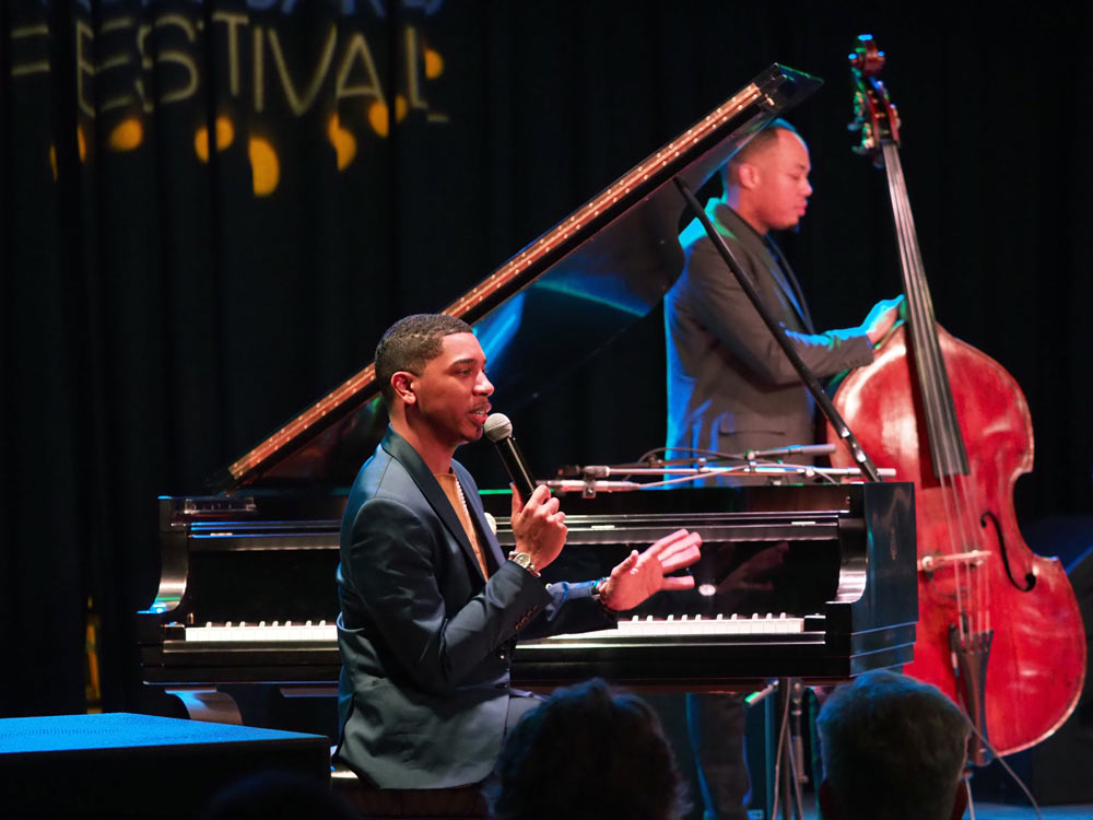 Christian Sands Trio performing on stage