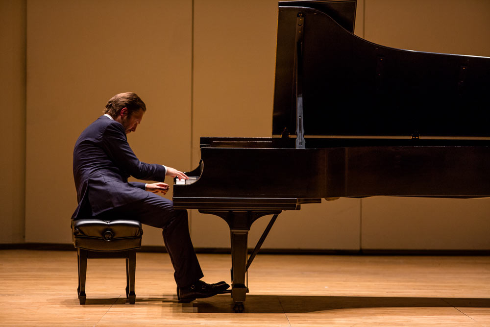 Leif Ove Andsnes on stage playing the piano