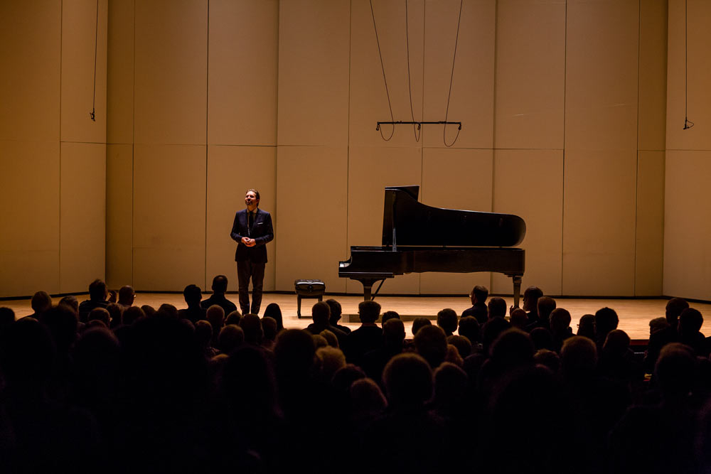 Leif Ove Andsnes standing on stage smiling after performance