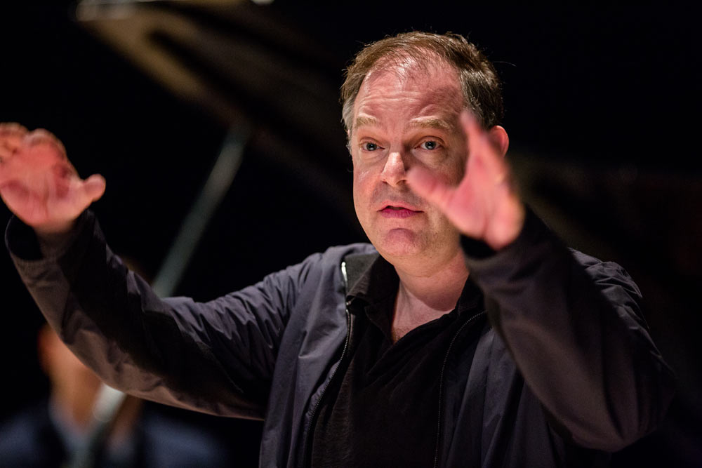 close up of Bill Charlap with his arms in the air