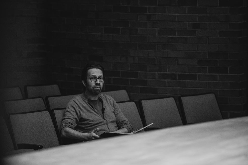 Leif Ove Andsnes sitting in the auditorium in black and white