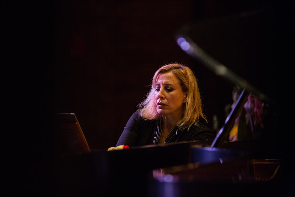 close up of woman playing the piano on stage