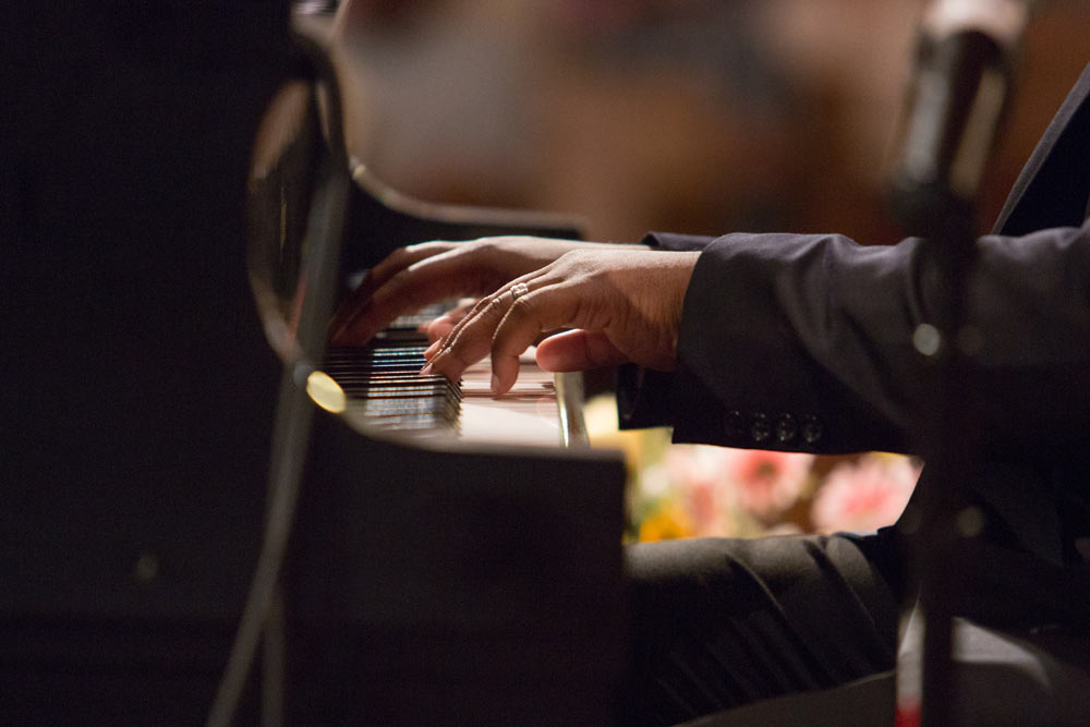 close up of man playing the piano