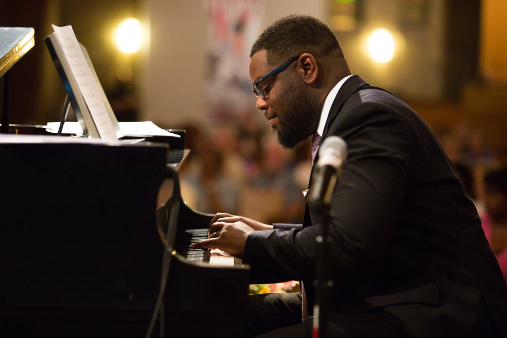 Rufus Ferguson playing the piano on stage