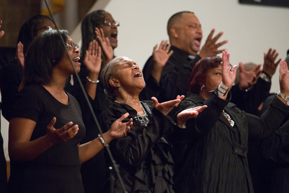 close up of choir on stage singing