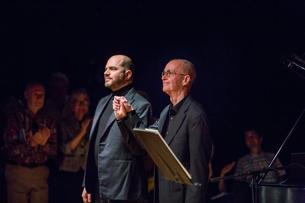 Kirill Gerstein and D. Terry Williams holding hands on stage after performance