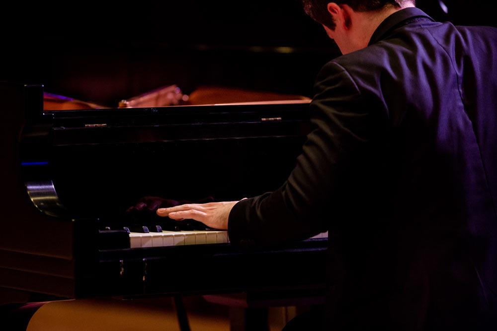 close up of Benjamin Grosvenor playing the piano