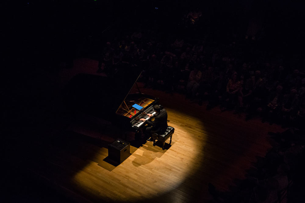 Michael Brown playing the piano on stage