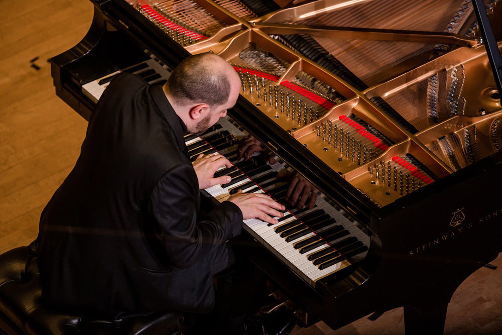 close up of Kirill Gerstein playing the piano