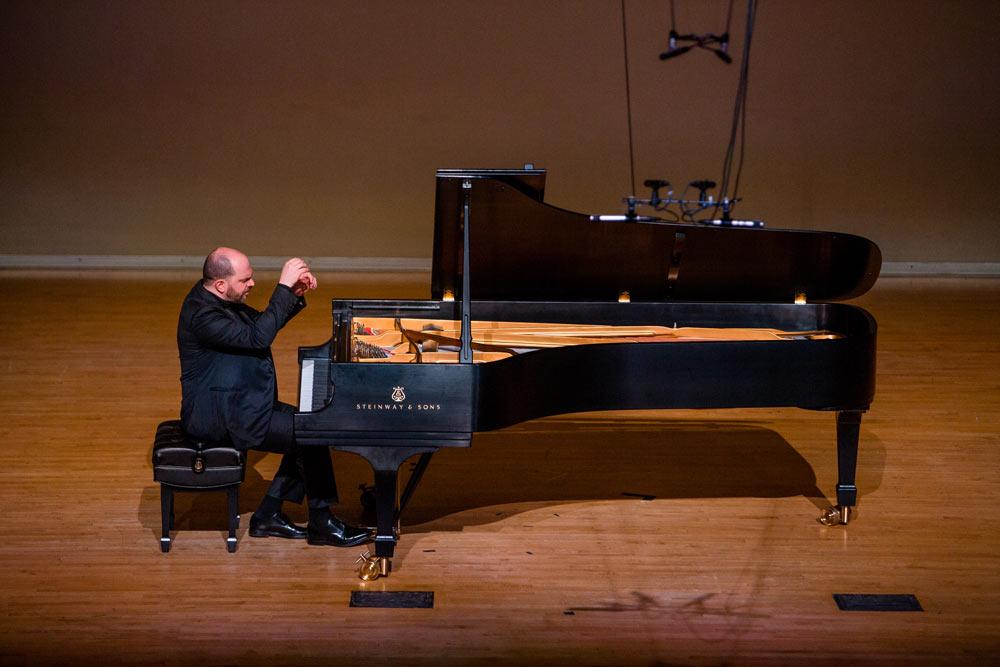 Kirill Gerstein playing the piano