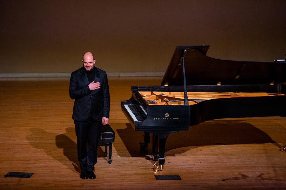Kirill Gerstein standing on the stage after performance