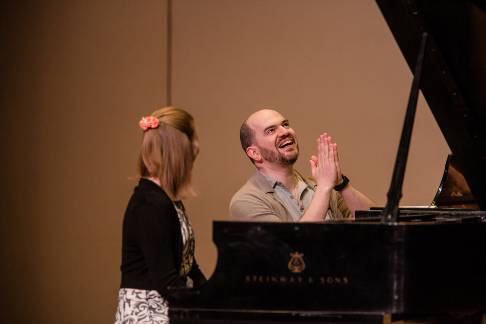 Kirill Gerstein teaching young woman how to play the piano