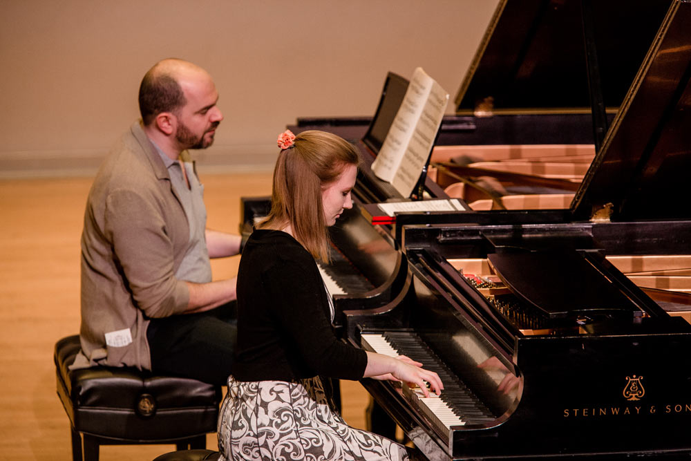 close up of woman and Kirill Gerstein playing the piano