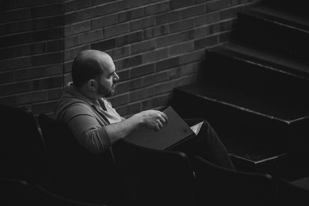 Kirill Gerstein sitting in a chair in black and white