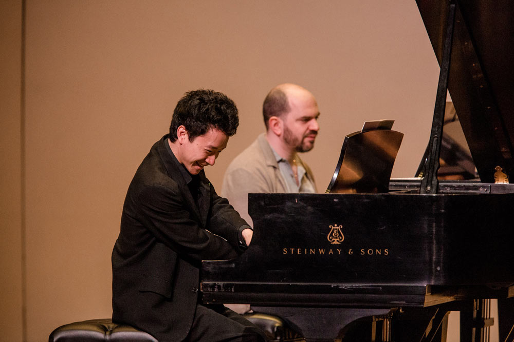 Kirill Gerstein teaching student how to play piano