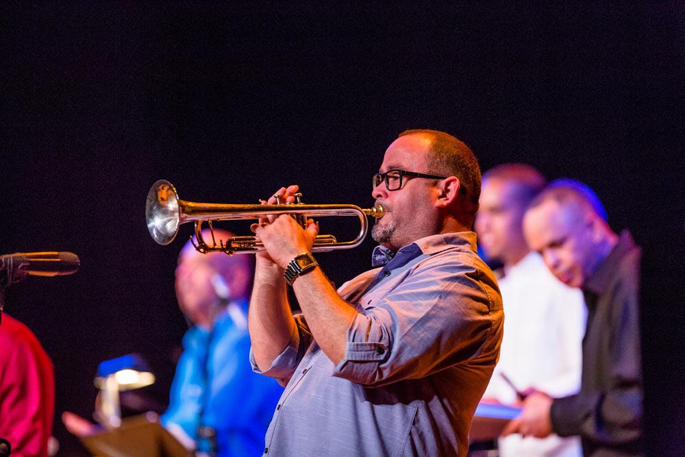 close up of gentleman playing trumpet