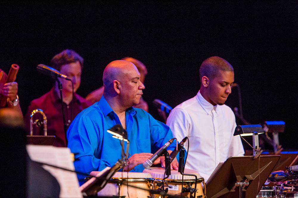 close up of Spanish Harlem Orchestra performing on stage