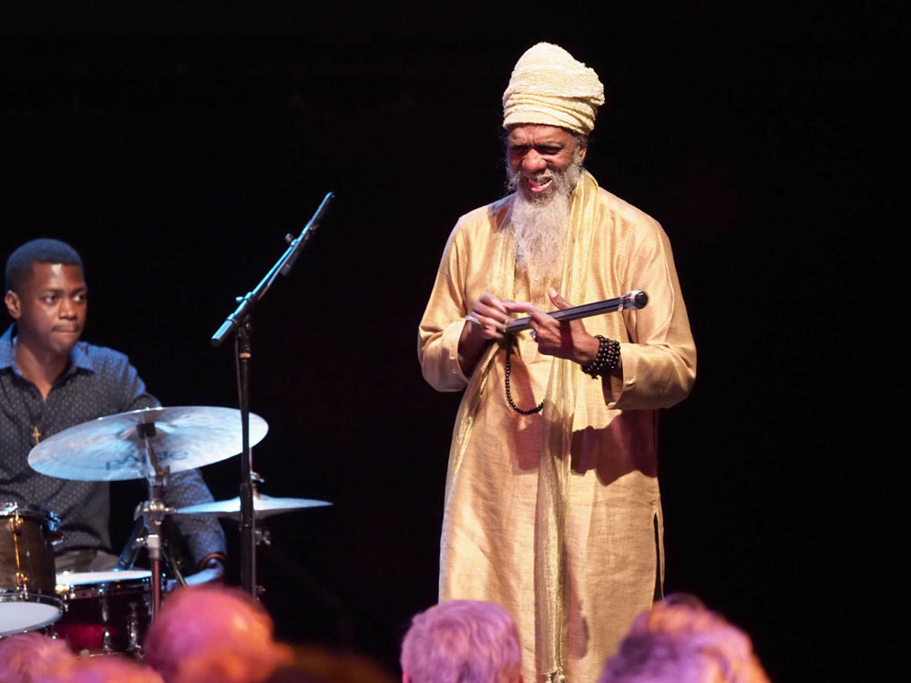 Dr. Lonnie Smith standing on stage