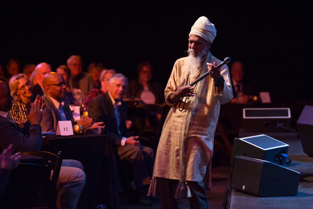Dr. Lonnie Smith performing in front of the audience off the stage