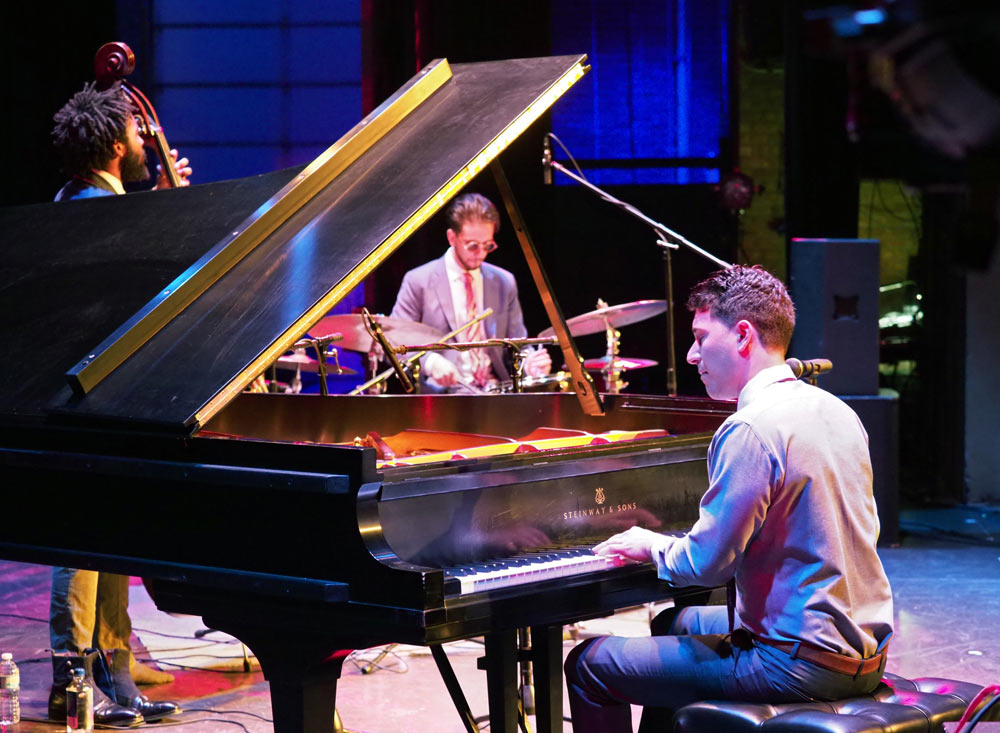 Emmet Cohen Trio performing on stage