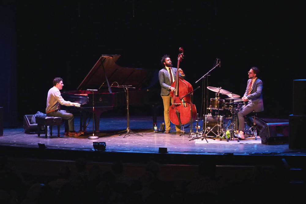 Emmet Cohen Trio performing on stage at Civic Auditorium