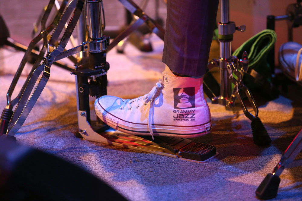 close up of the drummers Converse shoes