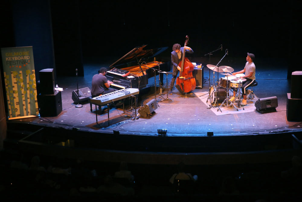 James Francies Trio performing on stage at the Civic Auditorium