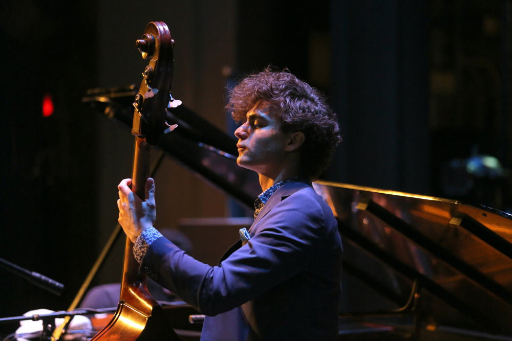 close up of gentleman playing an instrument on stage