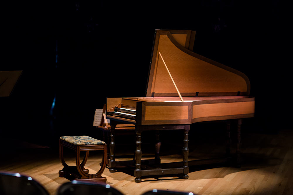 brown piano on stage