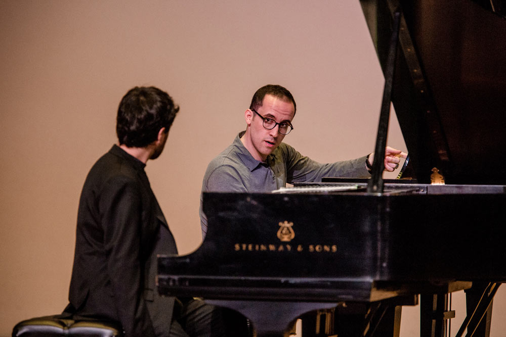 Igor Levit teaching someone how to play the piano