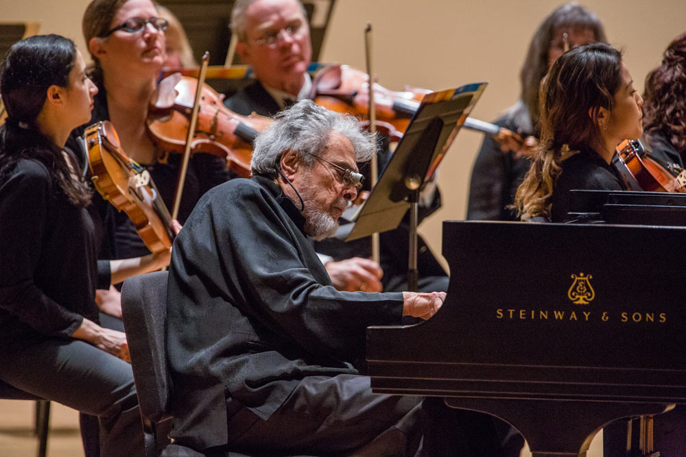Leon Fleisher playing piano with his orchestra