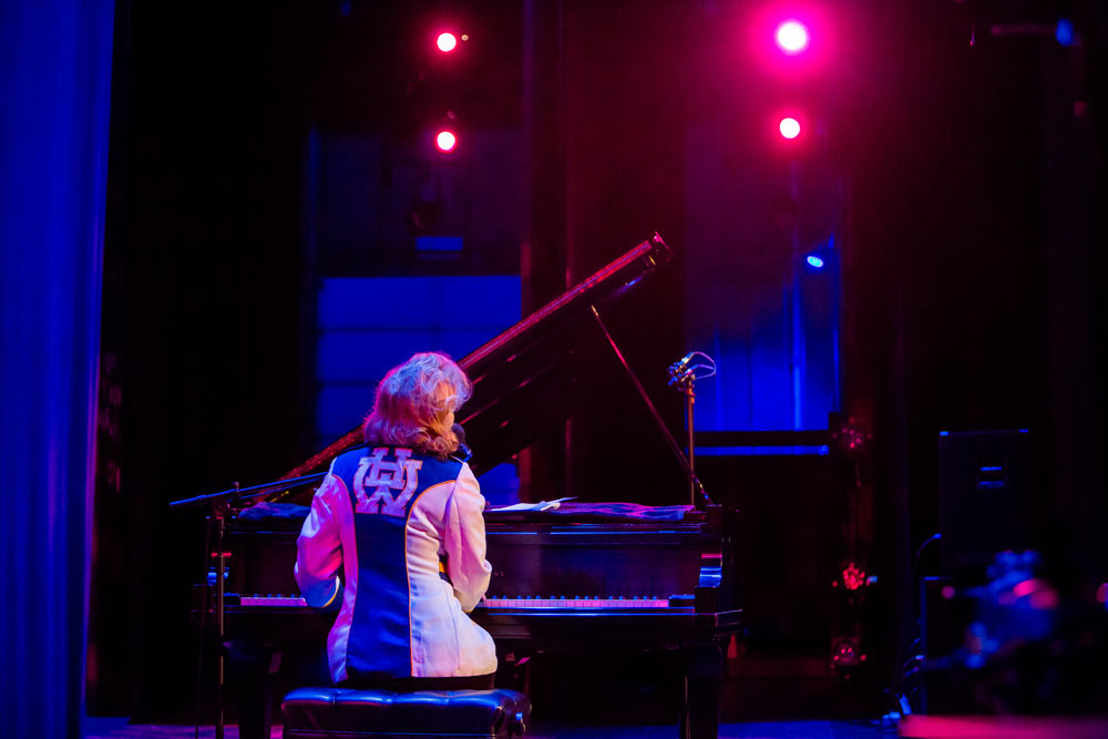 Nellie McKay playing piano on stage
