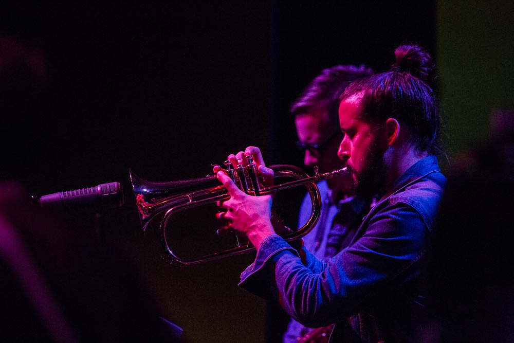 close up of two gentleman in Snarky Puppy playing instrument
