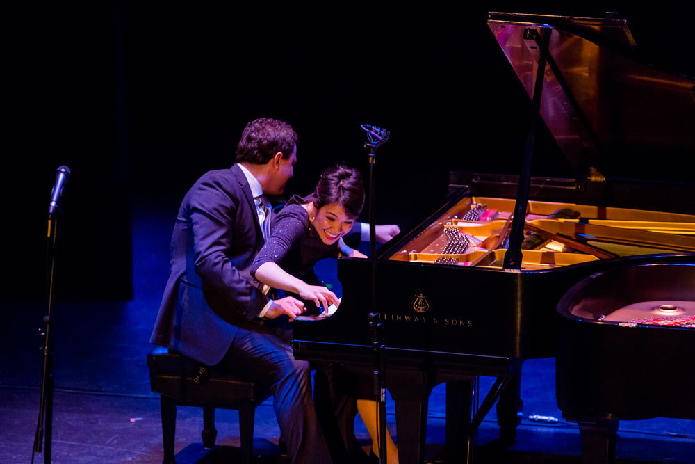Stephanie Trick & Paolo Alderighi playing piano on stage