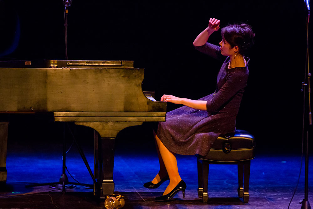 Stephanie Trick playing piano on stage