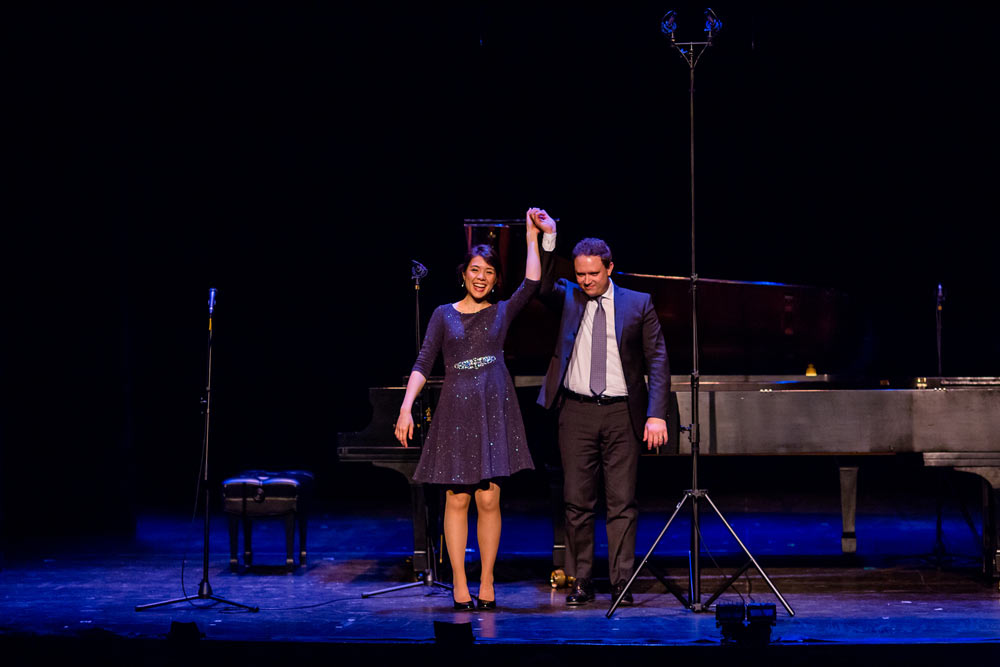 Stephanie Trick & Paolo Alderighi standing on stage bowing