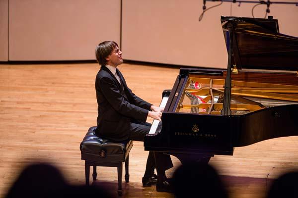 Daniil Trifonov performing for a crowd