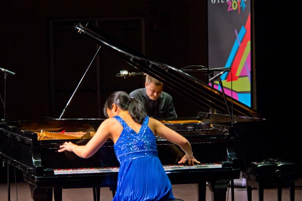 Greg Anderson and Elizabeth Roe playing pianos