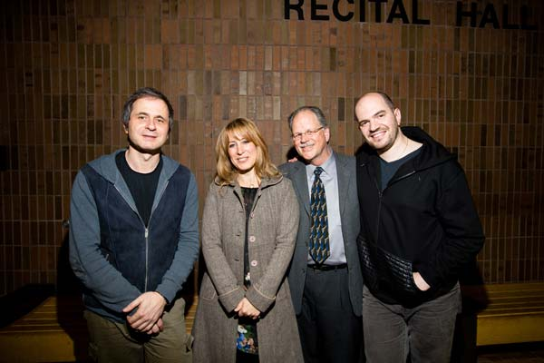a group of people outside of a recital hall