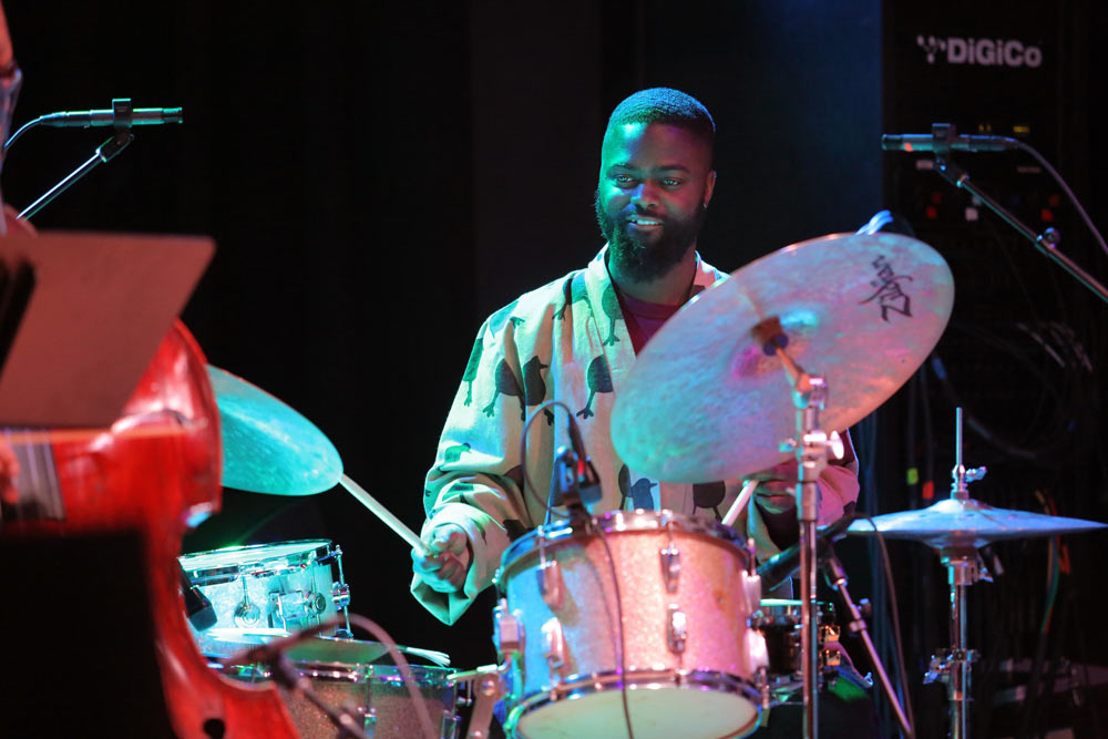 close up of gentleman playing the drums