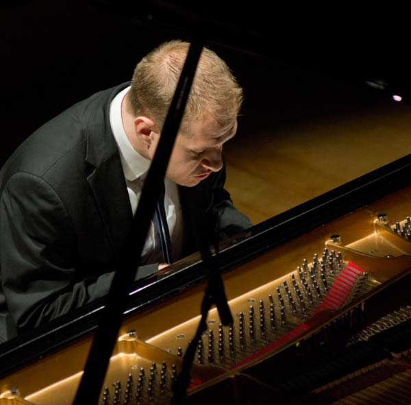 Jeremy Siskind hunched over piano